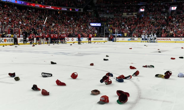 """Hats thrown in a hockey rink after a hat trick. Illustrates the phrase, """"throw your hat into the ring."""""""